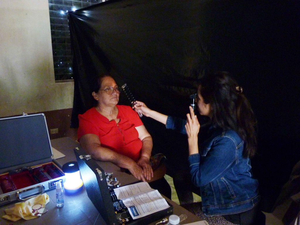 Dr. Tiffany Sieunarine performing retinoscopy to determine the patient's spectacle correction
