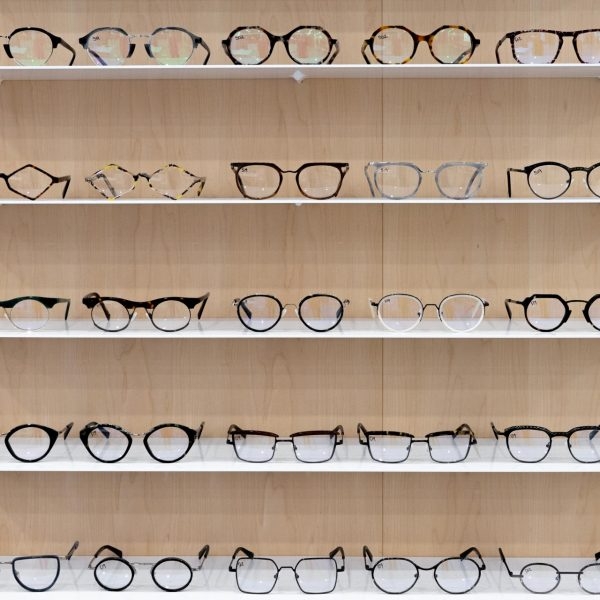 Bruno Chaussignand eyewear shelves with with wood panels